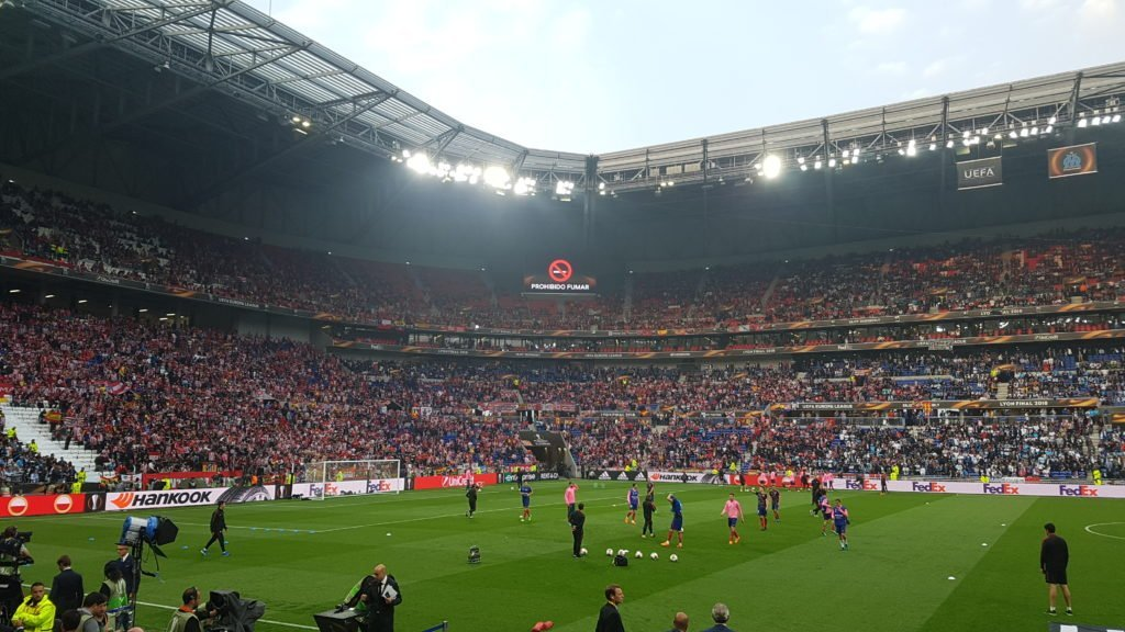 Atlético Madrid players warm-up for their UEFA Europa League Final against Marseille, whilst fans are informed of the No Smoking policy.