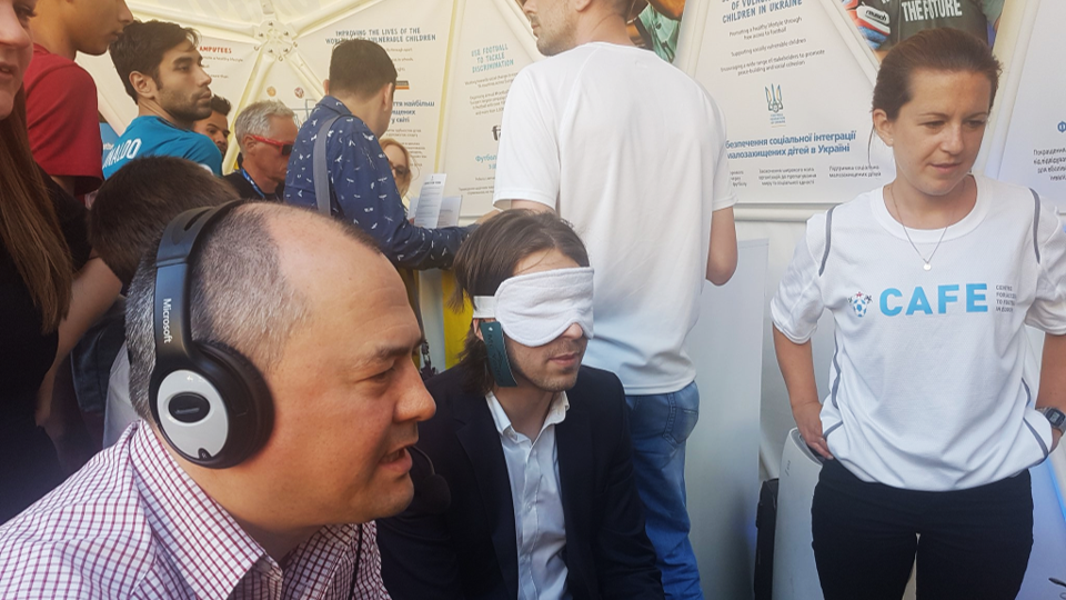 Healthy Stadia staff get involved with CAFE's audio-descriptive commentary activity at the Equal Game Zone in Kyiv.