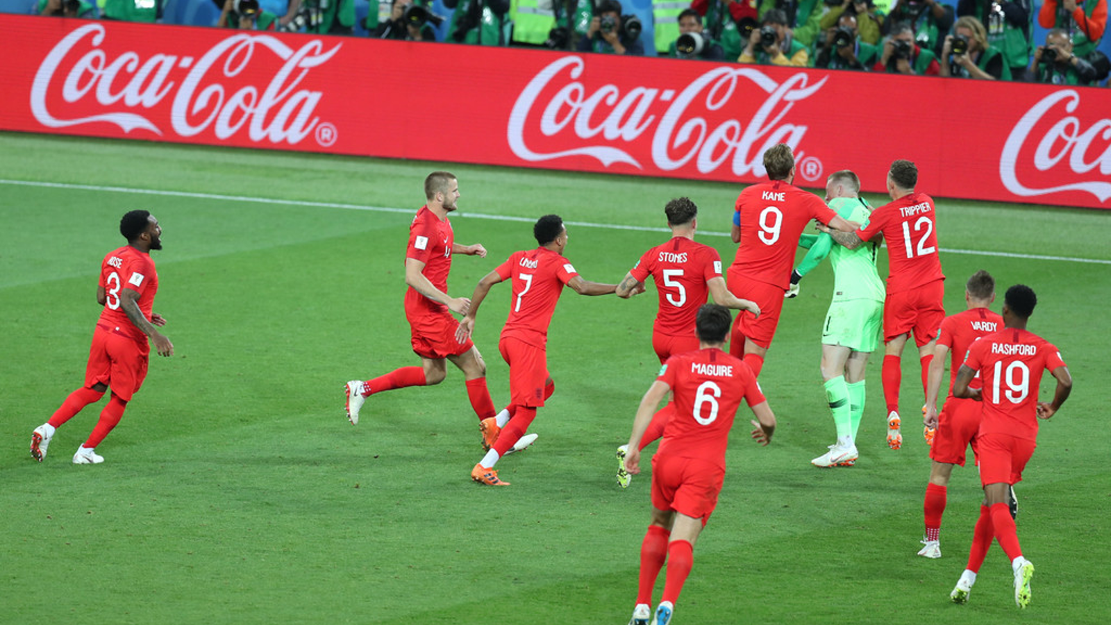 Coca-Cola adverts appear on electronic billboards as England qualify for the quarter finals at the World Cup.